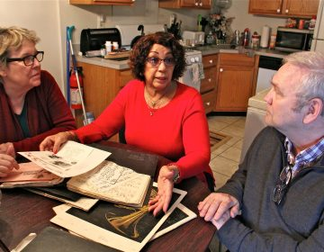 Margaret McGriff (center), widow of jazz organist Jimmy McGriff, shares her trove of papers from her husband's career with Jack McCarthy and Suzanne Cloud of the Philadelphia Jazz Project. (Emma Lee/WHYY)