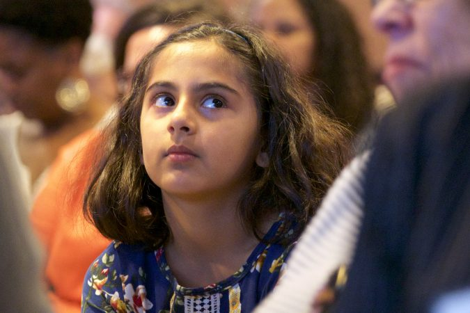 Talia Seshasai, 9 of Haddonfield, N.J. is all ears during Stacey Abrams' Radio Times interview, at WHYY, on Friday. (Bastiaan Slabbers for WHYY)