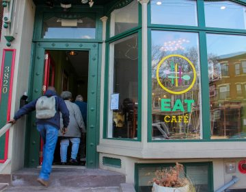 Patrons file into the EAT Café on Lancaster Avenue in University City. The pay-what-you-can restaurant will close on April 19 after 2 1/2 years in business. (Emma Lee/WHYY)