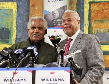 Former Philadelphia Mayor John Street (left) endorses mayoral candidate Anthony Williams during a press conference at Venango House in North Philadelphia. (Emma Lee/WHYY)