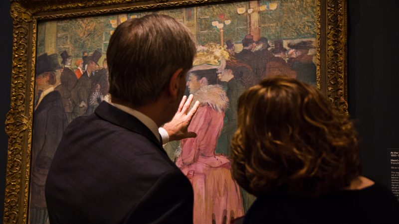 "Visitors admire Henri de Toulouse-Lautrec's ""At the Moulin Rouge, The Dance"" at ""The Impressionist's Eye"" exhibit at the Philadelphia Museum of Art. (Kimberly Paynter/WHYY)"