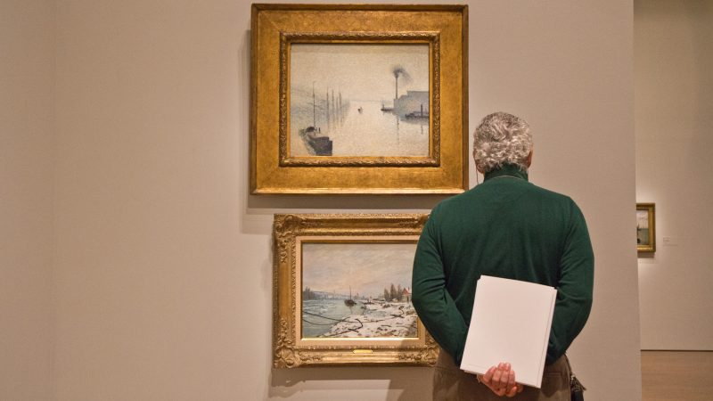 "Paintings by Camille Pissarro at the ""The Impressionist's Eye"" exhibit at the Philadelphia Museum of Art. (Kimberly Paynter/WHYY)"