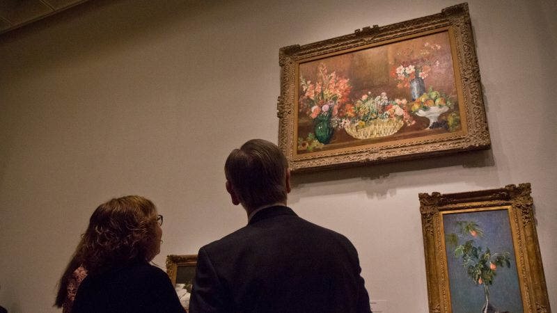 "Visitors admire ""Still Life with Flowers and Fruit"" by Pierre-Auguste Renoir at the ""The Impressionist's Eye"" exhibit at the Philadelphia Museum of Art. (Kimberly Paynter/WHYY)"