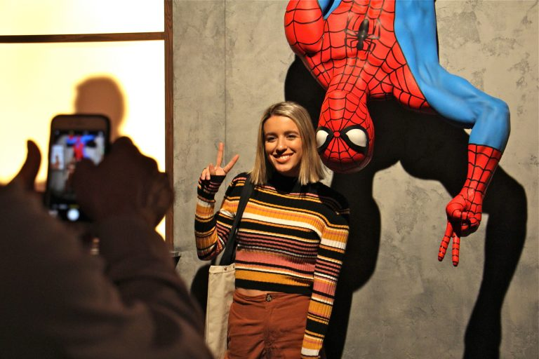 A visitor to the Franklin Institute's Marvel Comics exhibit poses for a photo with a life-size Spider-Man figure. The exhibit promises to be a crowd pleaser, with a quarter million visitors expected through the summer. (Emma Lee/WHYY)