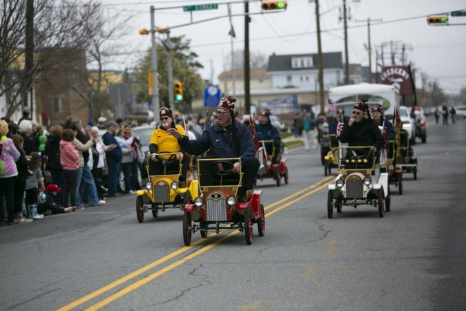 Small cars drive on Asbury Avenue as part of Ocean City's 34th annual Doo Dah Parade on Saturday, April 13, 2019. (Miguel Martinez for WHYY)