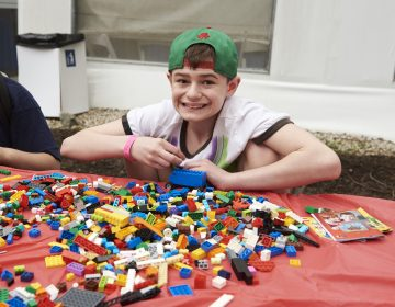 Brayden Tiscio, 12, builds a lego truck at the 20th Annual Autism Awareness Day event at the Philadelphia Zoo.  Brayden was diagnosed with Autism when he was three. (Natalie Piserchio for WHYY)
