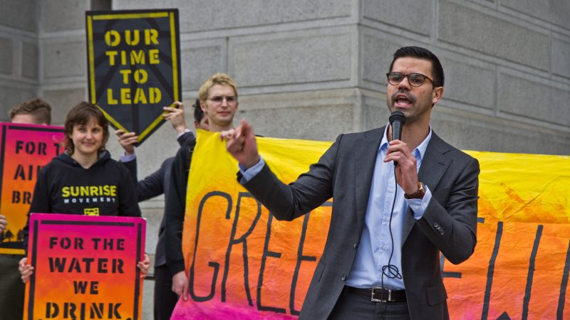 At-large city council candidate AdrianRivera-Reyes speaks at New Sunrise Movement's New Green Deal Rally at City Hall Monday. He is a biologist. (Kimberly Paynter/WHYY)