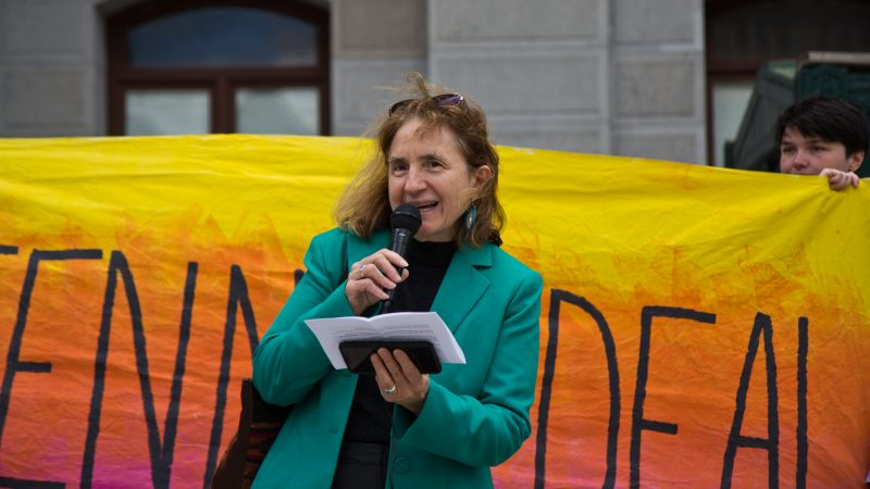 At-large city council candidate Sherrie Cohen speaks at New Sunrise Movement's New Green Deal Rally at City Hall Monday. (Kimberly Paynter/WHYY)