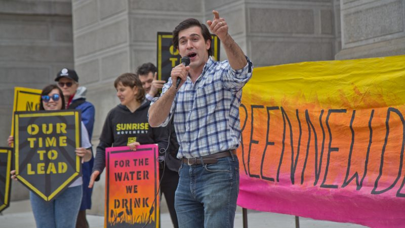 At-large city council candidate Justin DiBerardinis speaks at New Sunrise Movement's New Green Deal Rally at City Hall Monday. (Kimberly Paynter/WHYY)