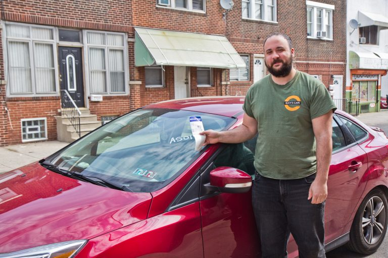 Mark Rascati has been a Philadelphia resident for 3 years. He delivers for Instacart and frequently runs into problems with parking and recently had his car towed. (Kimberly Paynter/WHYY)