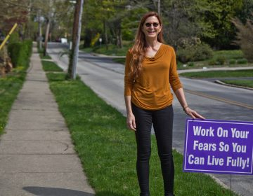 Meg Miller displays positive messages on her lawn and along the road she lives on in Wynnewood, Pa. (Kimberly Paynter/WHYY)