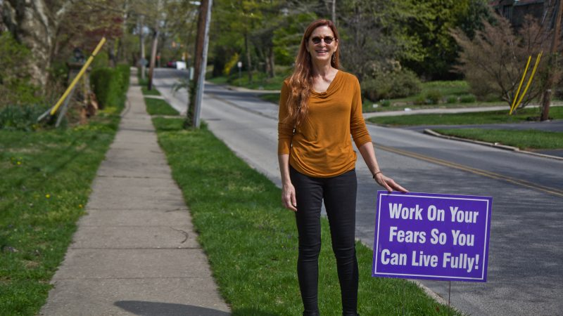 Meg Miller displays positive messages on her lawn and along the road she lives on in Lower Merion, Pa. (Kimberly Paynter/WHYY)