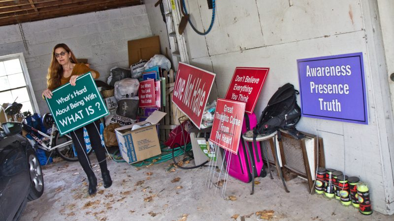 Meg Miller stores her signs in her garage, replacing the one in her yard every few weeks. (Kimberly Paynter/WHYY)