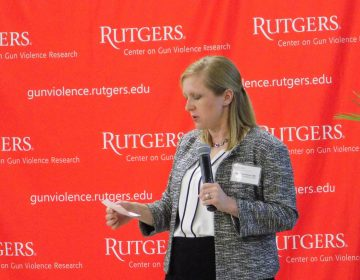 Dr. Stephanie Bonne is director of surveillance for New Jersey's Center on Gun Violence Research. She answered questions from the audience during the center's first conference at Rutgers University in New Brunswick. (Ximena Conde/WHYY)