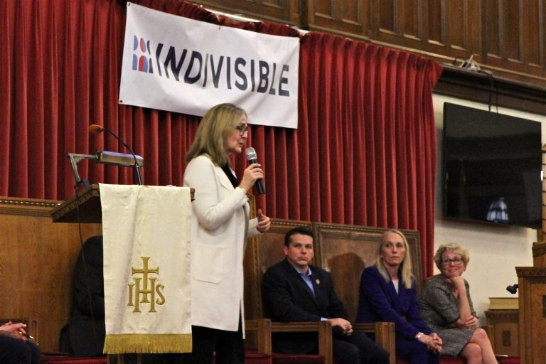 Southeastern Pennsylvania U.S. representatives (from left) Madeleine Dean, Brendan Boyle, Mary Gay Scanlon, and Chrissy Houlahan, address some of the most important concerns of Indivisible Project members during a forum at Tindley Temple United Methodist Church in Philadelphia. (Ximena Conde/WHYY)