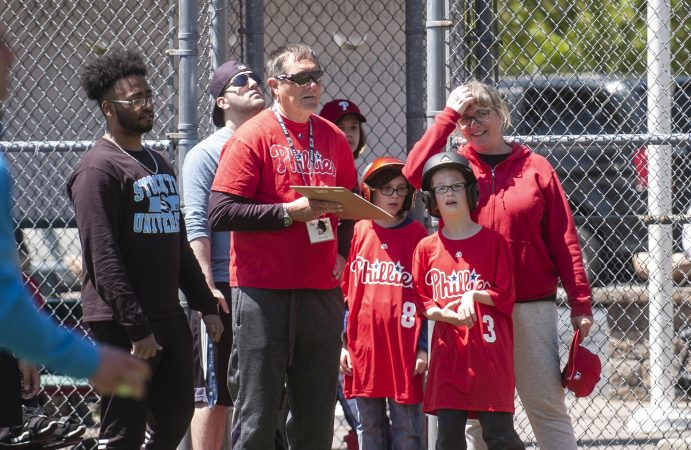 Volunteers and players watch the action during opening day at the South Jersey Field of Dreams in Absecon, New Jersey. (Anthony Smedile for WHYY)