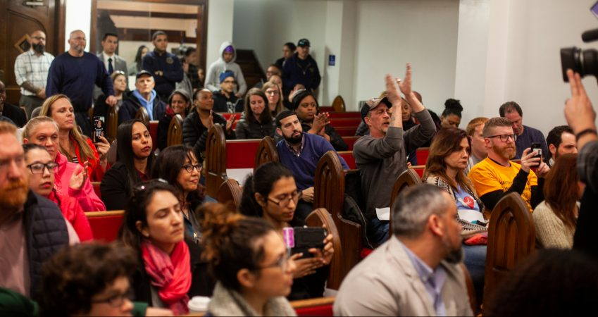 Philadelphia residents from Kensington and beyond crowd a public discussion in April on a proposed supervised injection site on Hilton Street near Kensington and Allegheny Avenue. (Brad Larrison for WHYY)