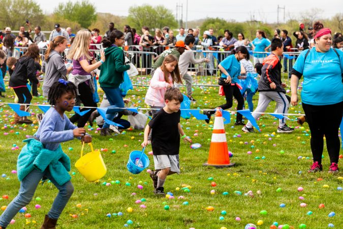 Following the Easter Egg drop children and some adults ran to collect them at the River Fields in Northeast Philadelphia. (Brad Larrison for WHYY)