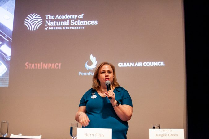 Beth Finn, a democratic candidate for Philadelphia City Council At-Large, speaks on environmental issues at the Academy of Natural Sciences Wednesday evening. (Brad Larrison for WHYY)