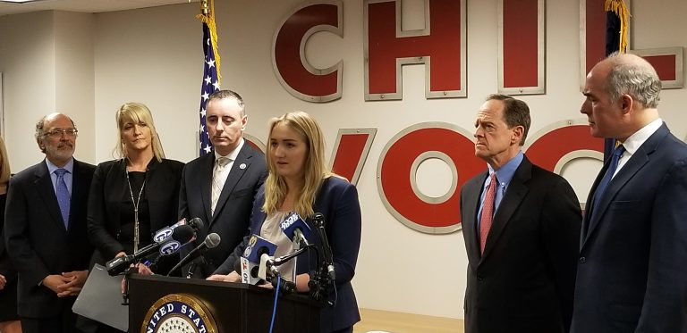 Madison Zezzo, center, speaks about the Combat Online Predators Act flanked by U.S. Rep. Brian Fitzpatrick (left) and U.S. Sens. Pat Toomey and Bob Casey (right). (Tom MacDonald/WHYY)