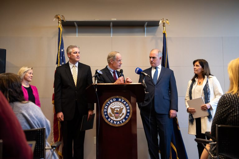 In a press conference, Del. Sen. Tom Carper, alongside Pa. Sen. Bob Casey, discusses measures pushing for a federal response to PFAS chemical contamination, following a roundtable discussion at the Horsham Township Library in Horsham, Pa. on Monday, April 8, 2019. (Kriston Jae Bethel for WHYY)