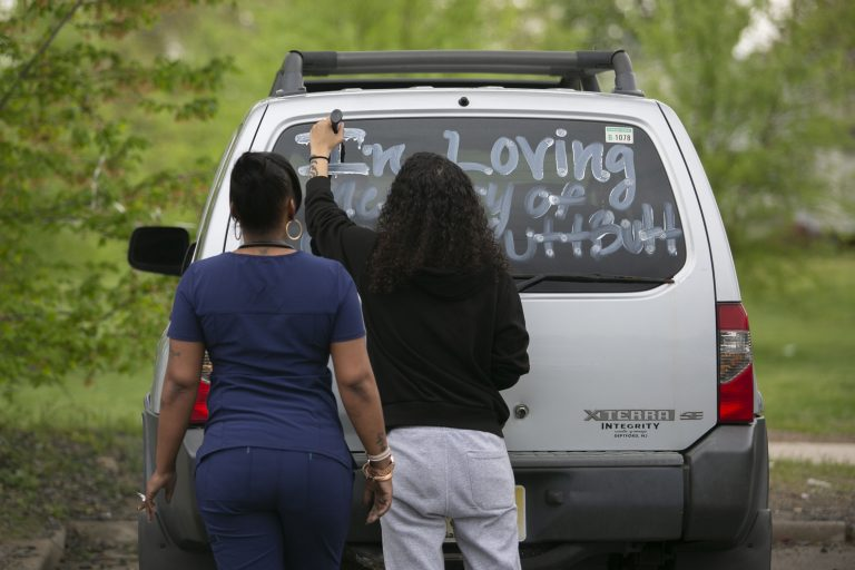 A community member writes a message on the back of her car to remember Sincere Howard and Shirleen Caban, who were killed on Sunday, April 21 at Von Nieda Park in Camden. A community rally was held to create safer environment for children on Thursday, April 25, 2019. (Miguel Martinez for WHYY)
