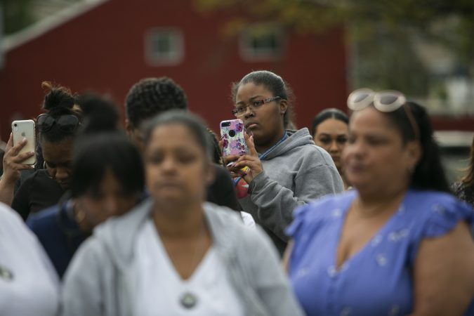 Camden residents participate in the community rally held in Camden to create safer environment for children on Thursday, April 25, 2019. (Miguel Martinez for WHYY)