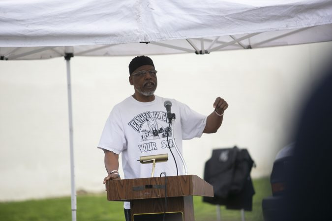 Community leader, Naim Muslim offer remarks in a community rally held in Camden to create safer environment for children on Thursday, April 25, 2019. (Miguel Martinez for WHYY)
