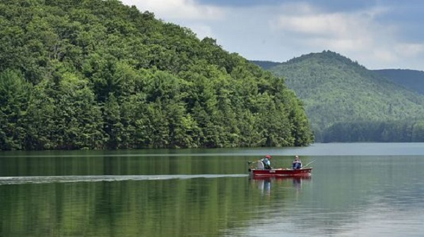 A couple spends the morning of Tuesday, July 18, 2017 fishing at Long Pine Run Reservoir in Michaux State Forest. (Markell DeLoatch/Public Opinion)