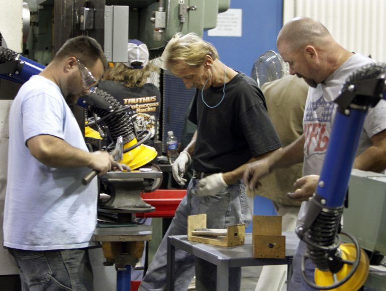 The state Department of Labor and Industry reported an increase in new jobs in March. (Keith Srakocic/AP Photo)