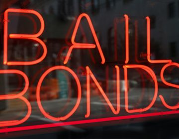 In this Tuesday, July 7, 2015, file photo, a sign advertising a bail bonds business is displayed near a jail and courthouse complex (Kathy Willens/AP Photo, File)