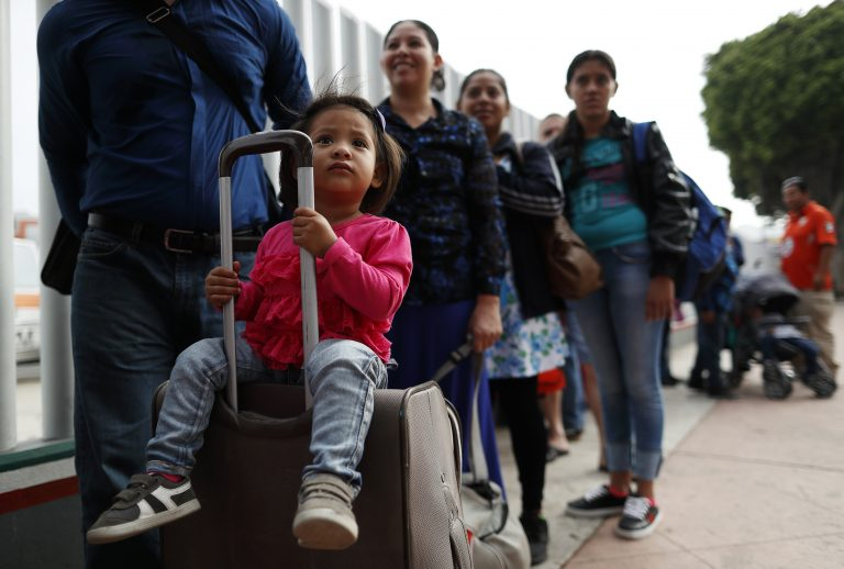 Merari Calderon, of El Salvador, lines up with her father, Alexander Calderon, left, to cross into the U.S. to begin the process of applying for asylum Thursday, July 26, 2018, near the San Ysidro port of entry in Tijuana, Mexico (Gregory Bull/AP Photo)