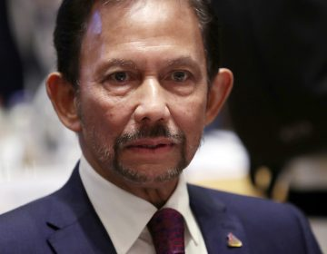 In this Oct. 18, 2018, file photo, Brunei's Sultan Hassanal Bolkiah attends a round table meeting at the ASEM 12 in Brussels. (Francisco Seco/AP Photo, File)