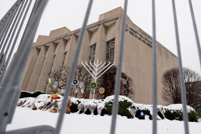Barricades surround the gardens outside the Tree of Life Synagogue Monday, Feb. 11, 2019, in Pittsburgh's Squirrel Hill neighborhood where Robert Bowers is accused of killing 11 and wounding multiple others during an attack on that Pittsburgh synagogue in October of 2018. Bowers was arraigned charges on nineteen additional in federal court on Monday. (AP Photo/Keith Srakocic)