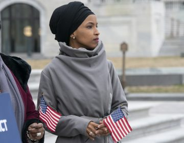 Rep. Ilhan Omar, D-Minn., stands with fellow Democrats as they rally outside the Capitol ahead of passage of H.R. 1,