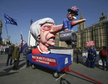 Anti-Brexit demonstrators with an effigy of British Prime Minister Theresa May near College Green at the Houses of Parliament in London, Monday, April 1, 2019. (Jonathan Brady/PA via AP)