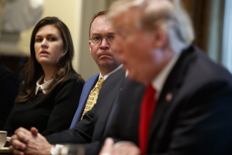 White House press secretary Sarah Sanders and acting White House Chief of Staff Mick Mulvaney listen as President Donald Trump speaks during a meeting with NATO Secretary General Jens Stoltenberg in the Cabinet Room of the White House, Tuesday, April 2, 2019, in Washington. (Evan Vucci/AP Photo)
