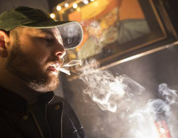 In this Friday, March 29, 2019 photo, a man smokes marijuana at a Spleef NYC canna-cocktail party in New York. As more states make it legal to smoke marijuana, some government officials, researchers and others worry what that might mean for one of the country's biggest public health successes: curbing cigarette smoking. (Mary Altaffer/AP Photo)