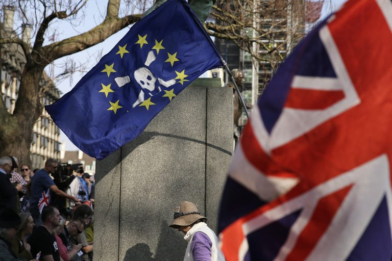 In this March 29, 2019, file photo, Pro-Brexit leave the European Union supporters wave flags in Parliament Square at the end of the final leg of the