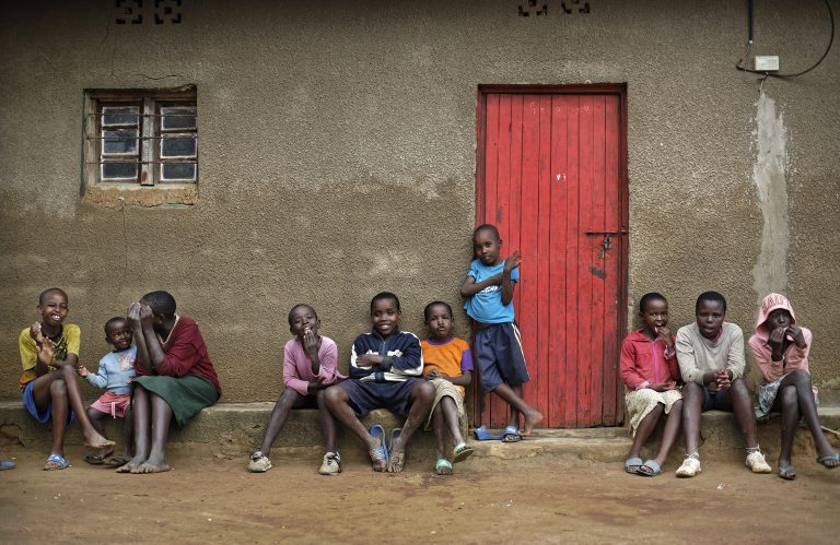 In this photo taken Thursday, April 4, 2019, the children of genocide survivors and perpetrators play together in the reconciliation village of Mbyo, near Nyamata, in Rwanda. Twenty-five years after the genocide the country has six