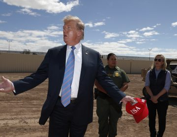 President Donald Trump visits a new section of the border wall with Mexico in Calexico, Calif., Friday April 5, 2019. Gloria Chavez with the U.S. Border Patrol, center, and Homeland Security Secretary Kirstjen Nielsen listen. (Jacquelyn Martin/AP Photo)