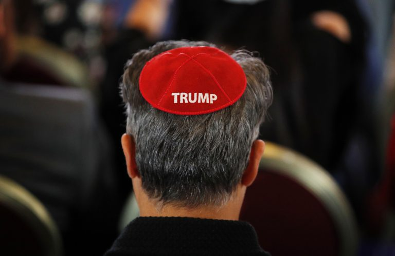 An attendee wears a yarmulke with the word