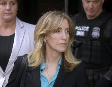 In this April 3, 2019 file photo, actress Felicity Huffman arrives at federal court in Boston to face charges in a nationwide college admissions bribery scandal. In a court filing on Monday, April 8, 2019, Huffman agreed to plead guilty in the cheating scam. (Steven Senne/AP Photo)
