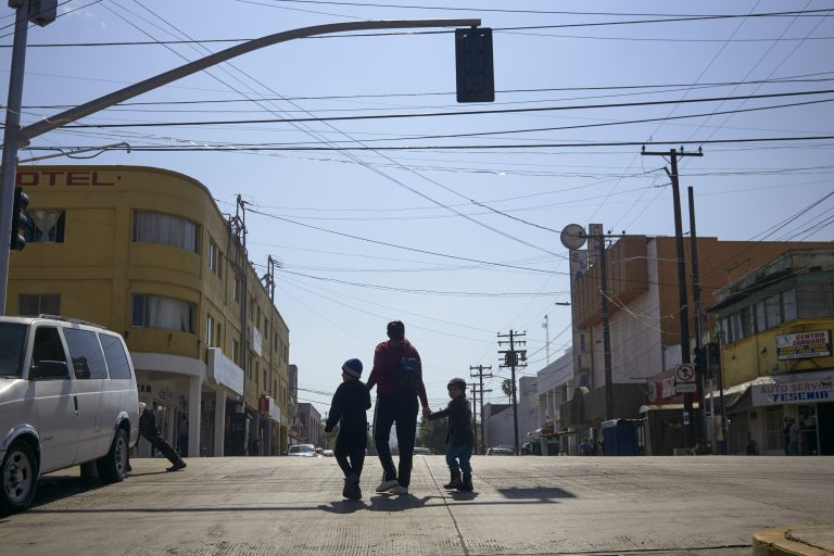 In this March 5, 2019 file photo, Ruth Aracely Monroy walks with her sons in Tijuana, Mexico. After requesting asylum in the United States, the family was returned to Tijuana to wait for their hearing in San Diego. (Gregory Bull/AP Photo)