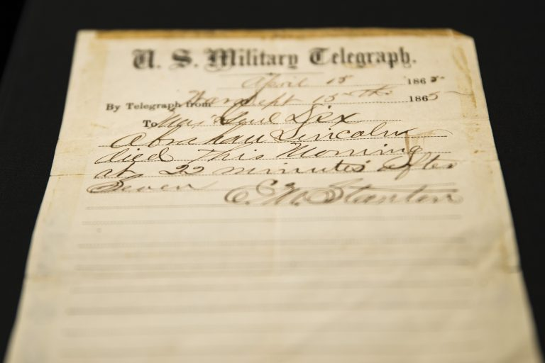 This photo shows a handwritten notification of President Abraham Lincoln's death that is being offered for sale by Raab Collection in Ardmore, Pa., Thursday, April 11, 2019. The telegram was written inside a home where Lincoln was rushed after being shot at Ford's Theater on April 14, 1865. (Matt Rourke/AP Photo)