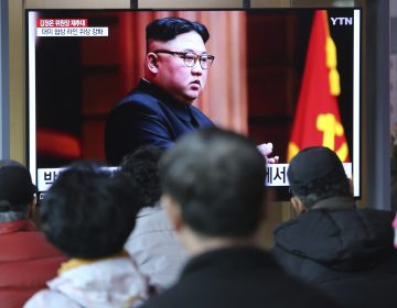 People watch a TV screen showing a file image of North Korean leader Kim Jong Un during a news program at the Seoul Railway Station in Seoul, South Korea, Friday, April 12, 2019. Kim was elected chairman of the State Affairs Commission, and a new premier was chosen by the government's parliament, the Korean Central News Agency reports. (Ahn Young-joon/AP Photo)