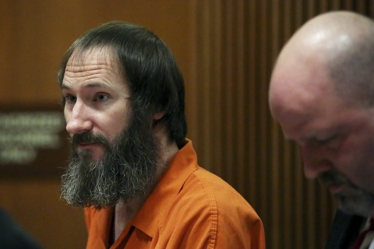 Johnny Bobbitt stands in the courtroom during his sentencing hearing at Burlington County Superior Court in Mount Holly, N.J., Friday, April 12, 2019. Bobbitt, the homeless veteran who admitted to conspiring with a New Jersey couple in a GoFundMe scam that raised more than $400,000, was sentenced Friday to five years' probation. (Tim Tai/The Philadelphia Inquirer via AP, Pool)