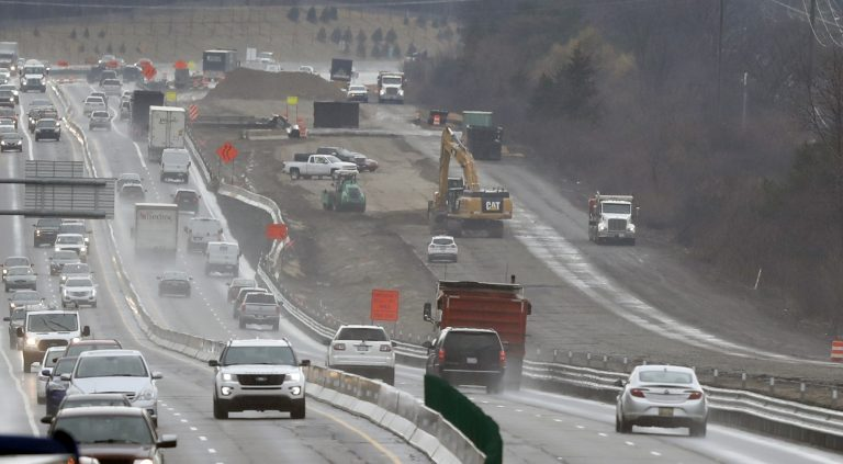 In a Friday, April 12, 2019 photo, Interstate Highway 75 construction continues in Troy, Mich. After passing waves of tax cuts in recent years, some Republican-dominated states have decided it's time to make a big exception, calling for tax increases to fix roads crumbling from years of low funding and deferred maintenance. (Carlos Osorio/AP Photo)