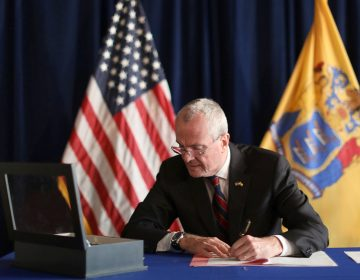 In this photo provided by the New Jersey Office of the Governor, N.J. Gov. Phil Murphy signs the Medical Aid in Dying for the Terminally Ill Act Friday, April 12, 2019 at the New Jersey Statehouse in Trenton, N.J. (New Jersey Office of the Governor via AP)