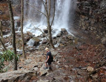 An unidentified woman makes her way to the base of the waterfalls just off the Glen Onoko Falls Trail in Jim Thorpe, Pa., Tuesday, April 16, 2019. The Pennsylvania Game Commission plans to close the popular falls trail to the public over safety concerns, sparking outrage from outdoors enthusiasts. (Michael Rubinkam/AP Photo)